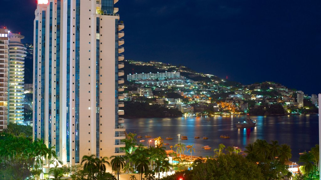 Acapulco showing a coastal town, a luxury hotel or resort and general coastal views