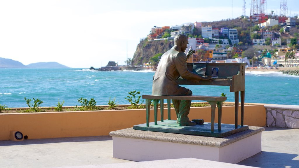 Mazatlan which includes views, music and a statue or sculpture