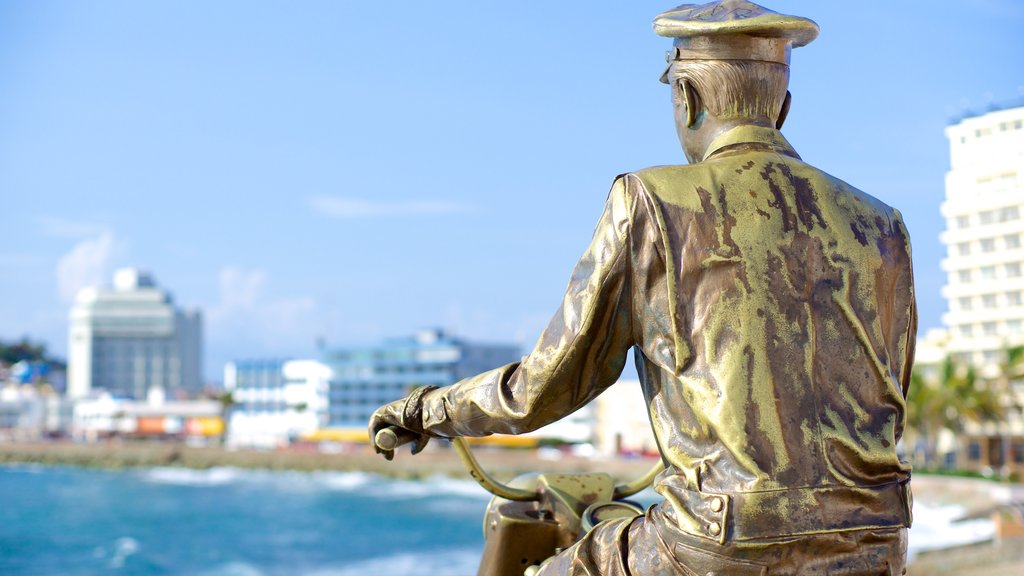 Mazatlan which includes general coastal views and a statue or sculpture