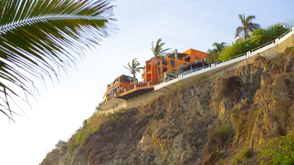 Mazatlan showing a house and a gorge or canyon