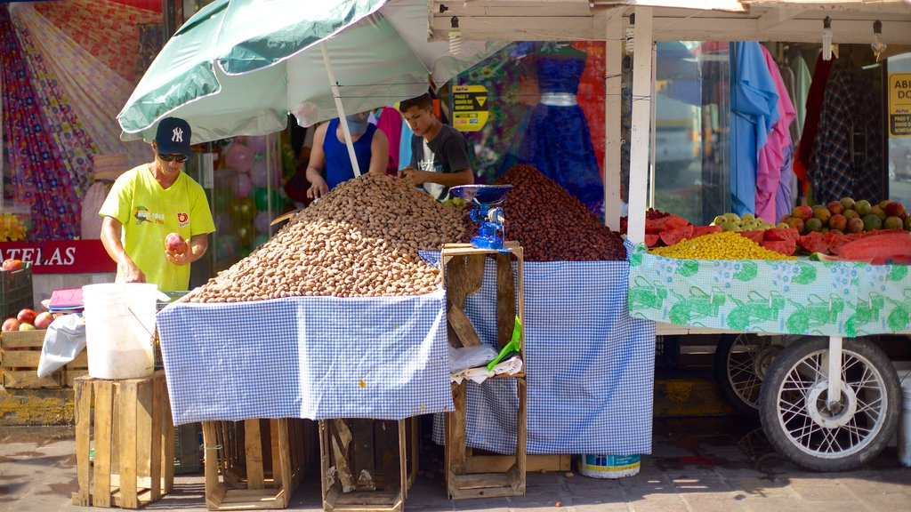 Mazatlan which includes food and markets as well as an individual male