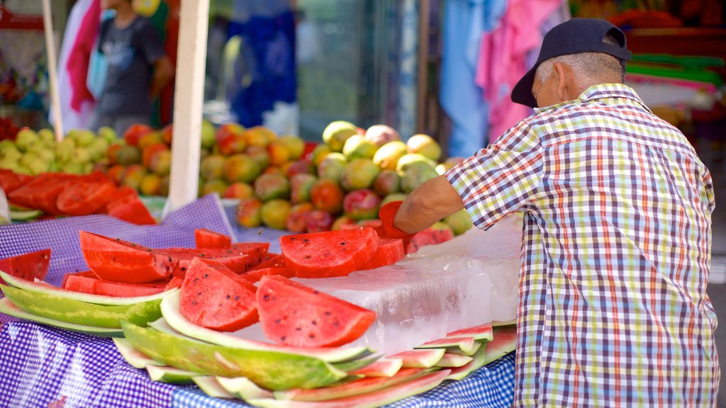 Mazatlan featuring food and markets as well as an individual male