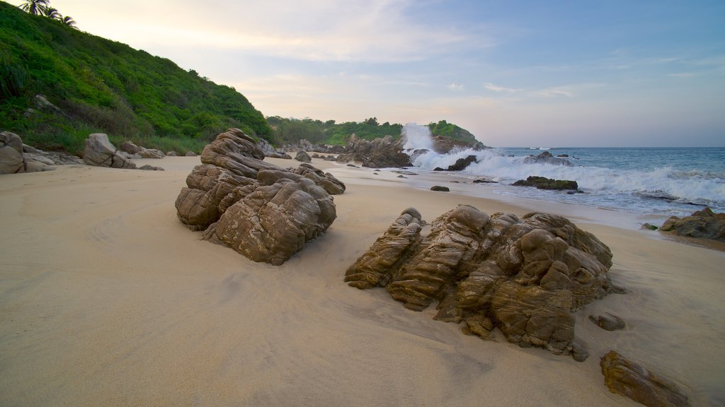 Bacocho Beach which includes landscape views, rocky coastline and a sandy beach