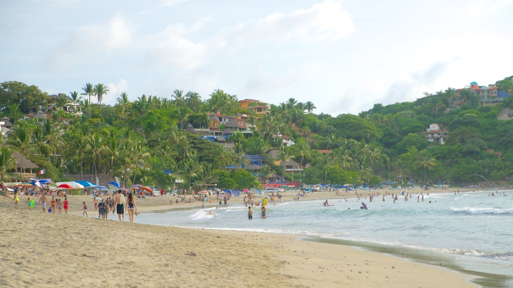 Sayulita showing a sandy beach, swimming and a coastal town