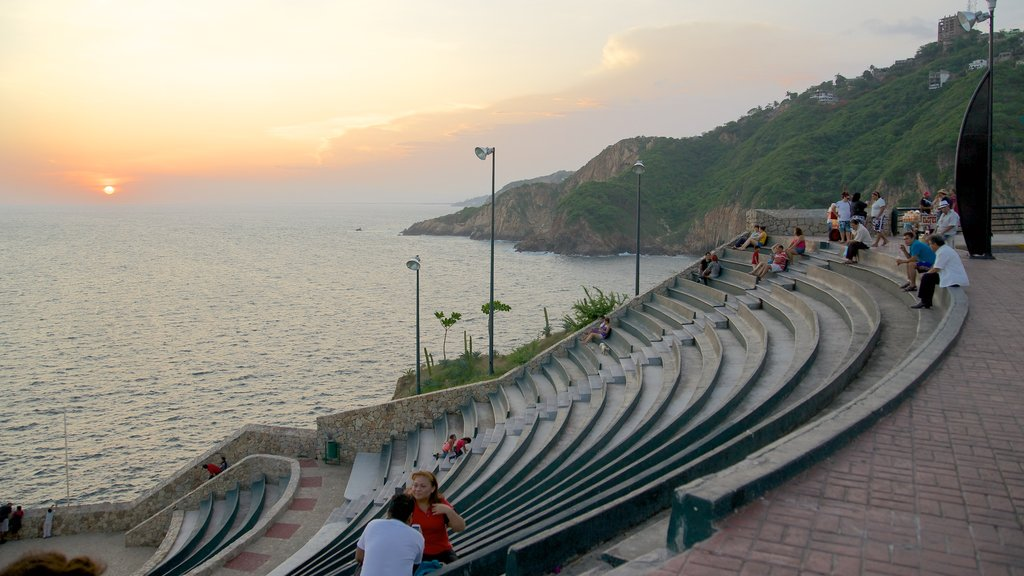 Sinfonia which includes general coastal views, a sunset and views