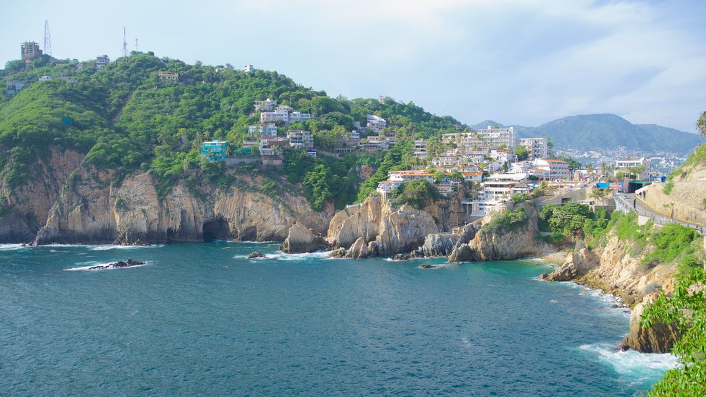 La Quebrada Cliffs which includes rocky coastline, a coastal town and a gorge or canyon
