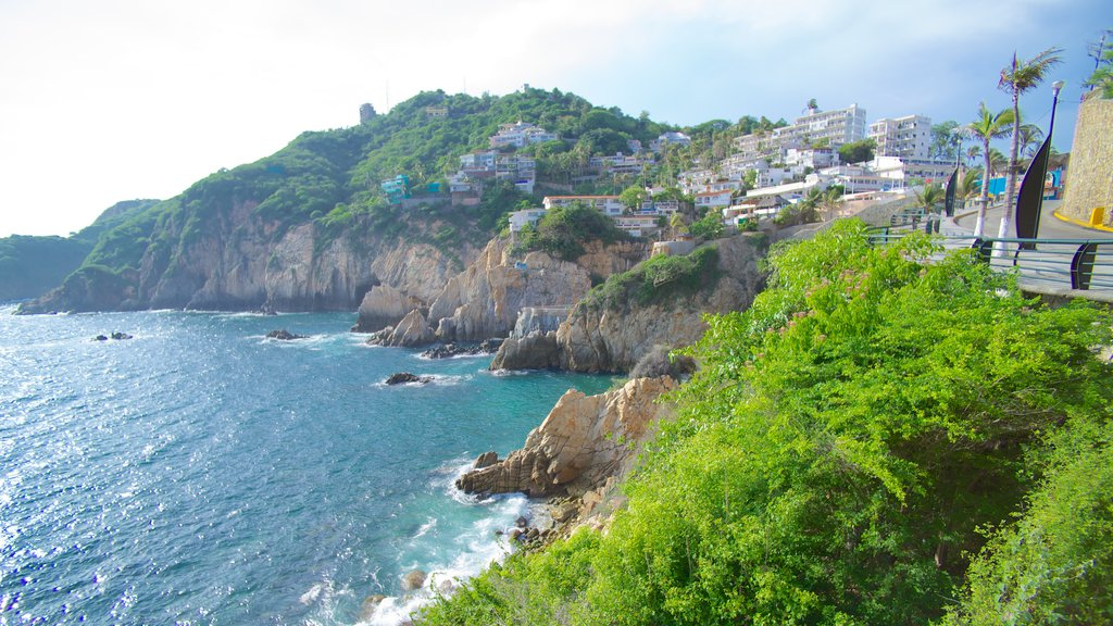 La Quebrada Cliffs featuring a gorge or canyon, rocky coastline and a coastal town
