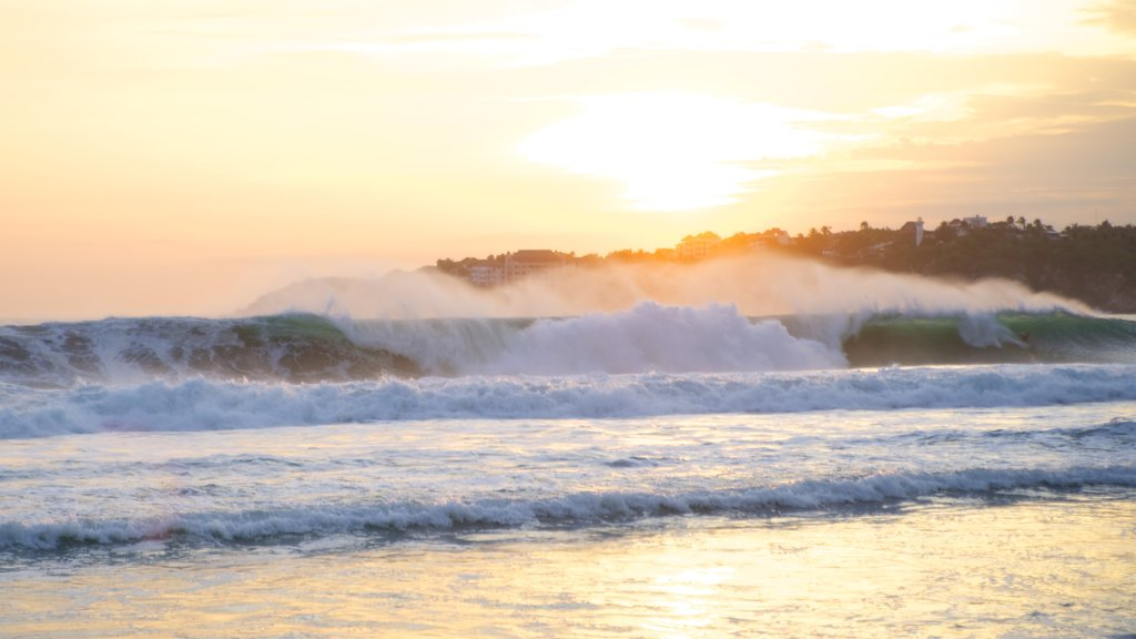 Zicatela Beach which includes general coastal views, a sunset and surf