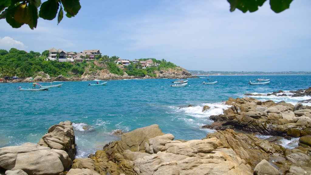 Puerto Angelito Beach showing rocky coastline and a bay or harbor
