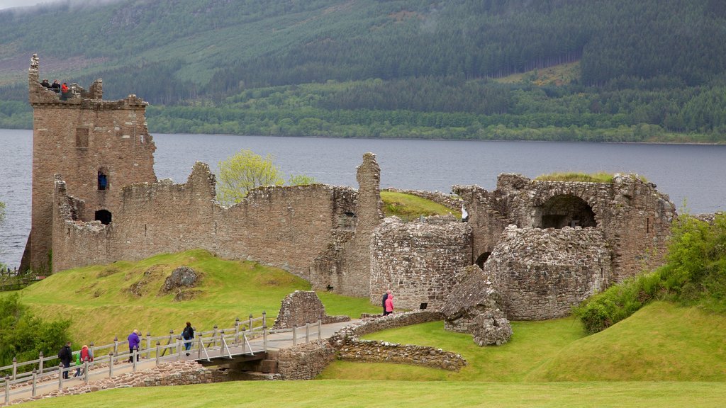 Urquhart Castle which includes building ruins and a lake or waterhole