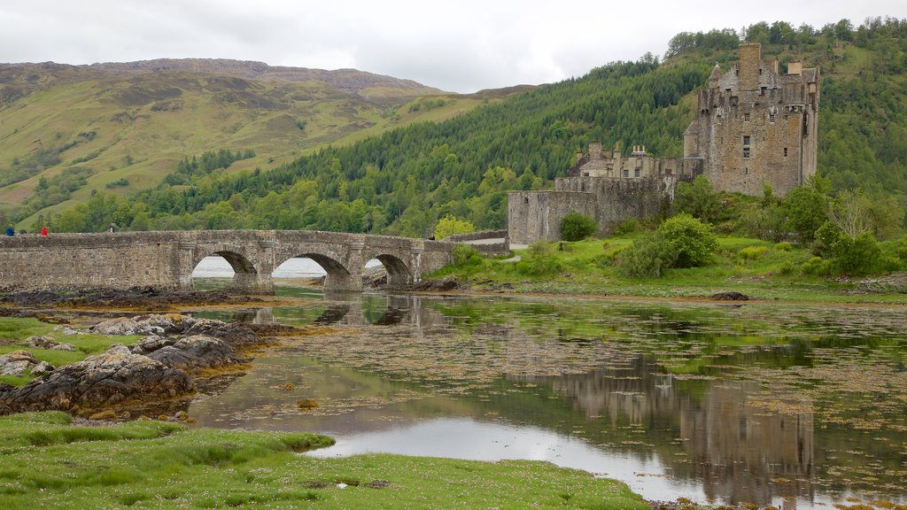 Eilean Donan Castle showing a bridge, a river or creek and chateau or palace