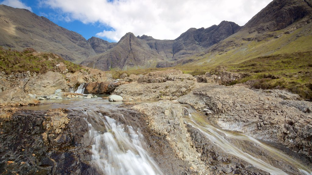 Isle of Skye which includes tranquil scenes, mountains and a river or creek