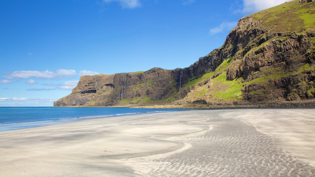 Isle of Skye showing a sandy beach, rugged coastline and tranquil scenes