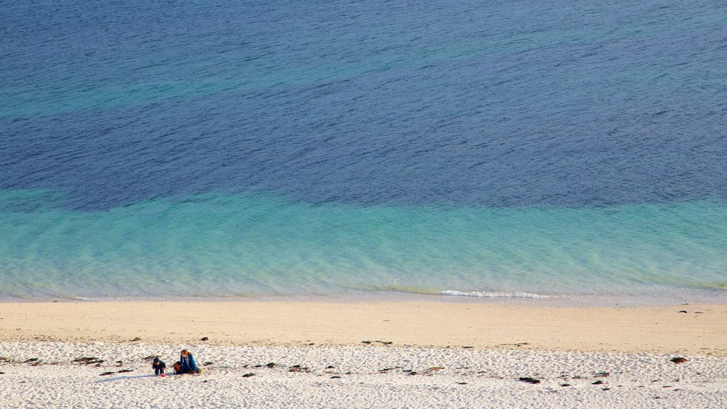 Isle of Skye showing a beach as well as a small group of people