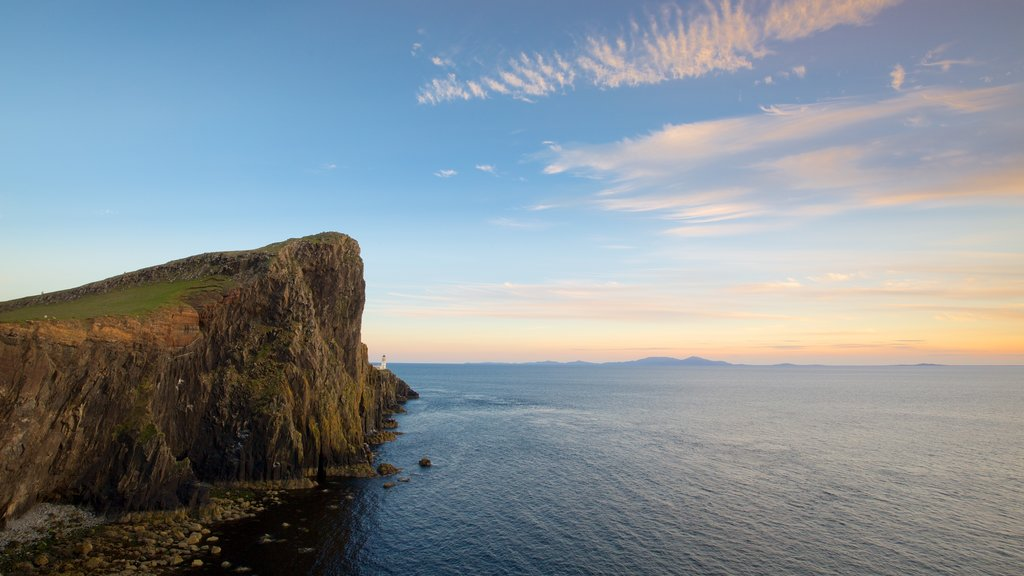 Isle of Skye featuring rocky coastline, mountains and a lighthouse