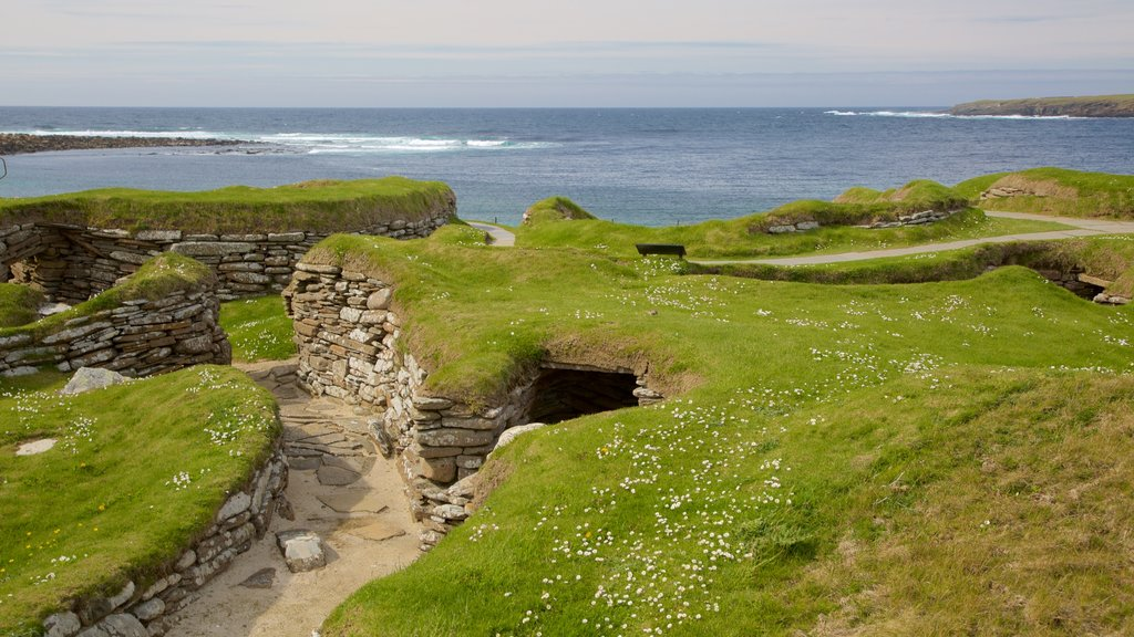 Skara Brae featuring heritage architecture, a bay or harbor and tranquil scenes