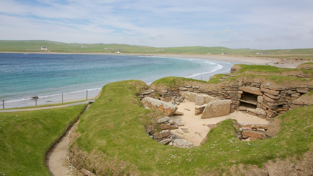 Skara Brae showing heritage elements, a bay or harbor and a beach