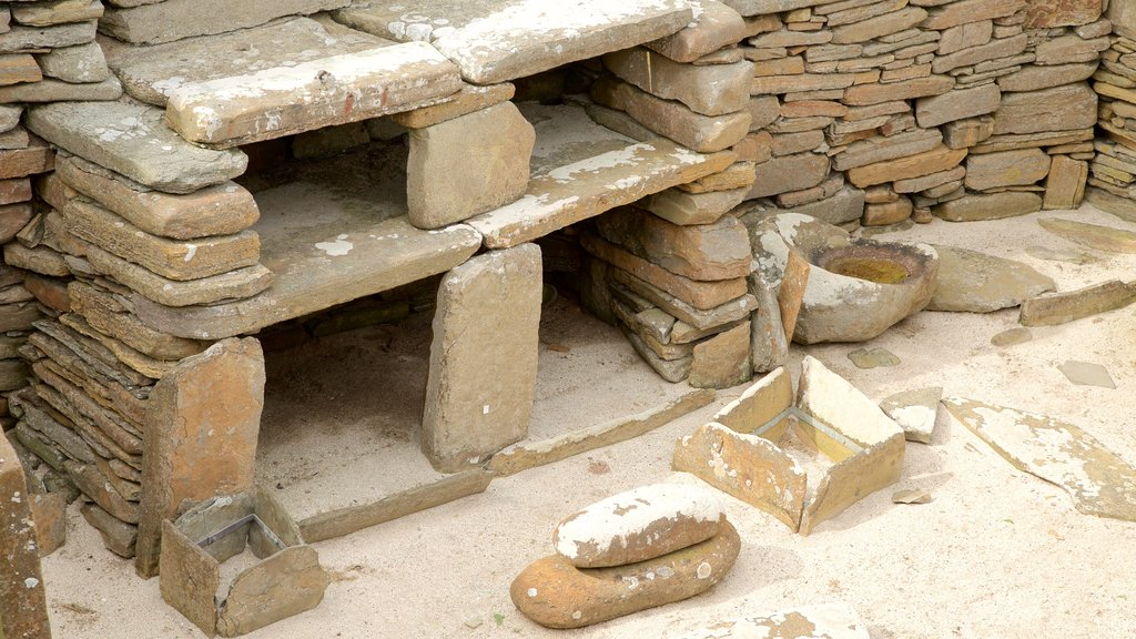 Skara Brae which includes heritage architecture, interior views and heritage elements
