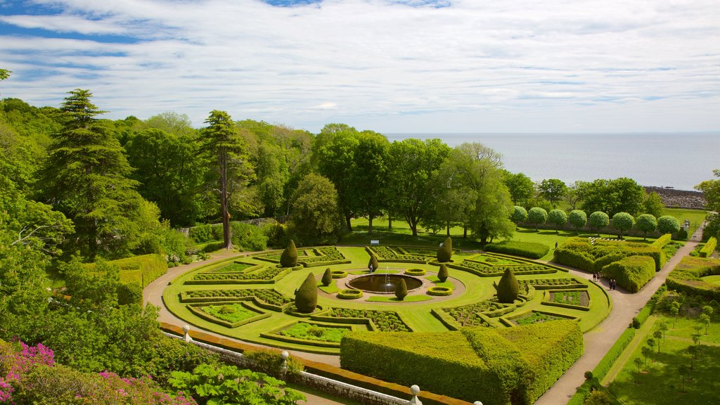 Dunrobin Castle featuring a garden, heritage elements and chateau or palace