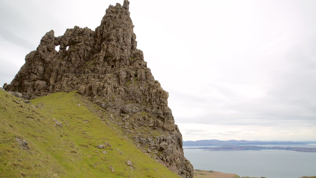 Old Man of Storr which includes tranquil scenes, a monument and a lake or waterhole