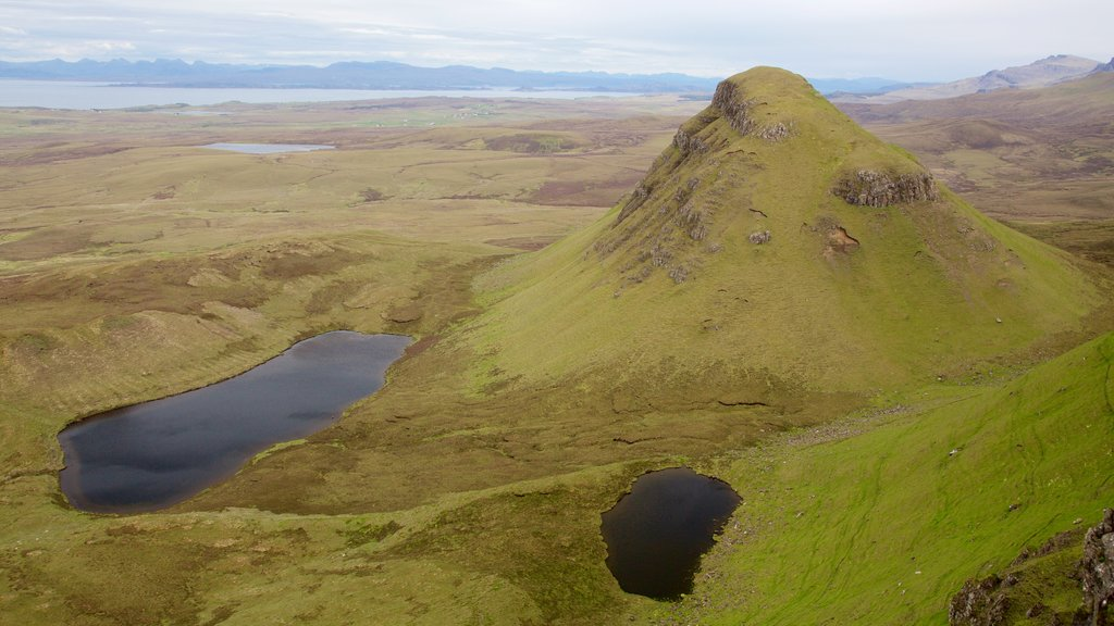 Quiraing which includes mountains, a pond and tranquil scenes