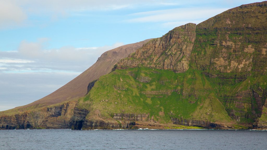 St. John\'s Head featuring mountains and rocky coastline