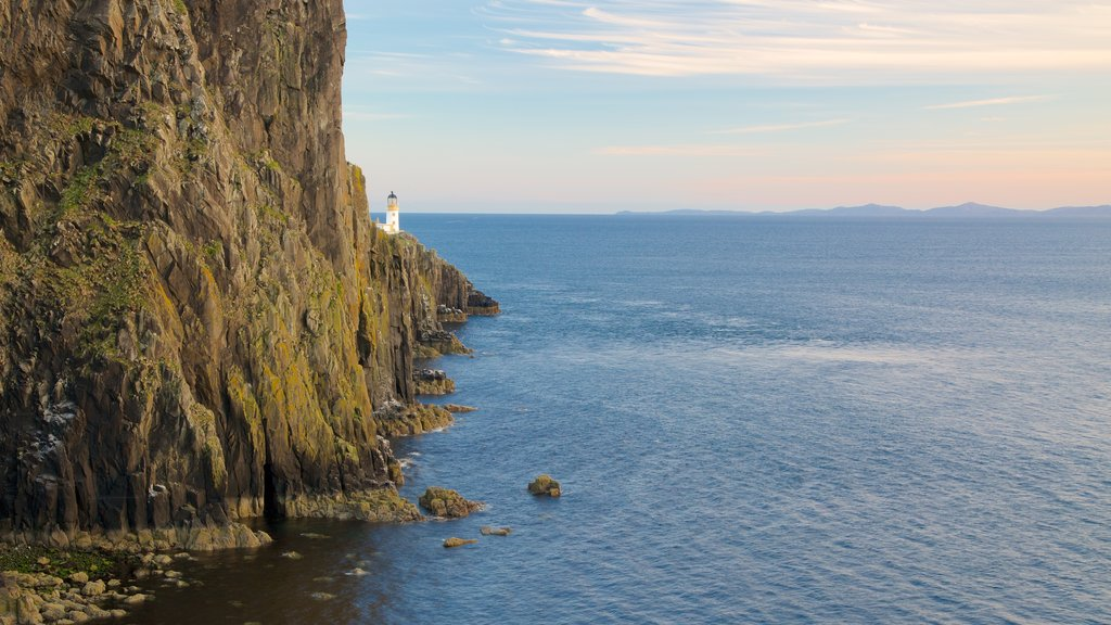 Isle of Skye featuring a lighthouse and rugged coastline