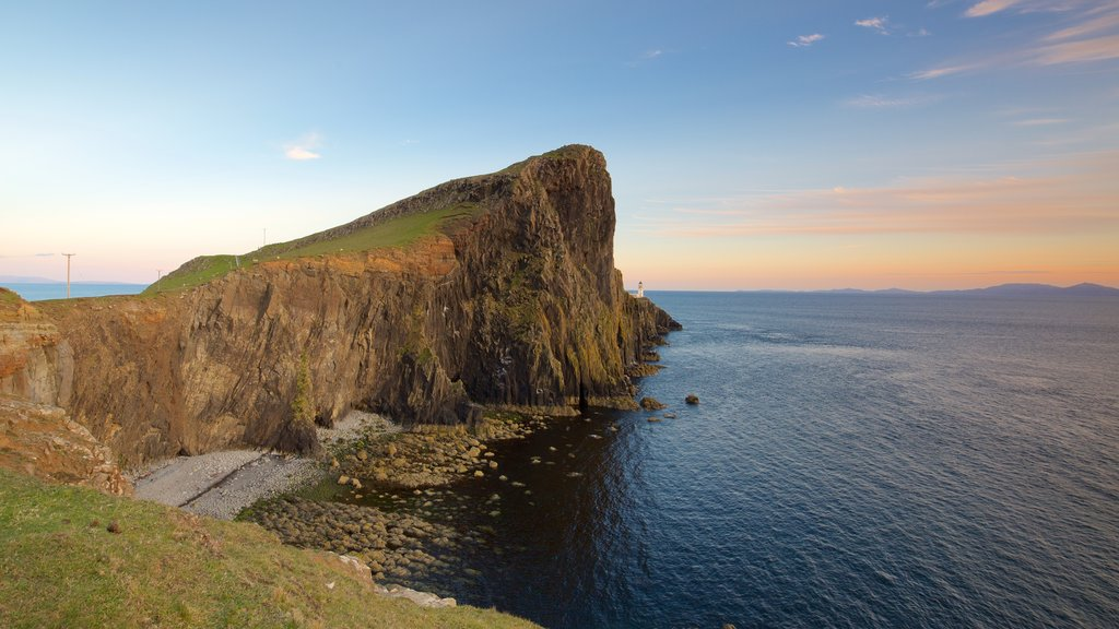 Neist Point Lighthouse which includes rocky coastline, a sunset and general coastal views