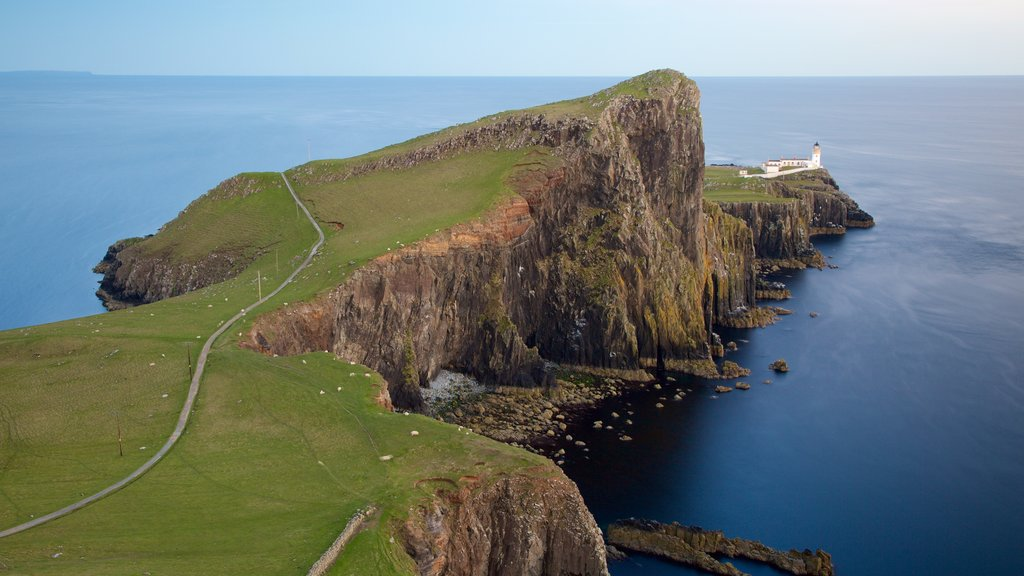Isle of Skye showing a lighthouse and rocky coastline