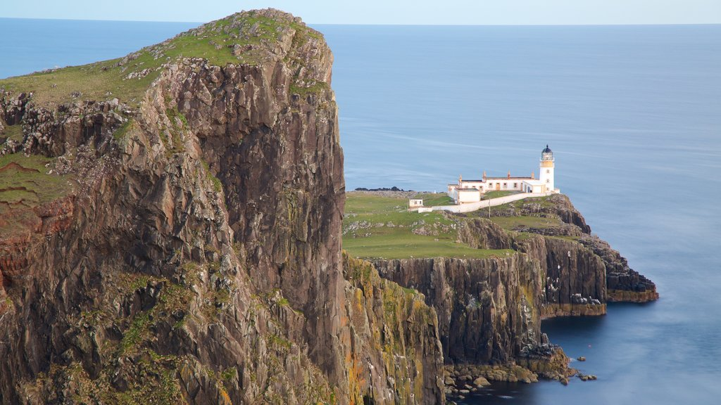 Isle of Skye which includes general coastal views, a lighthouse and mountains