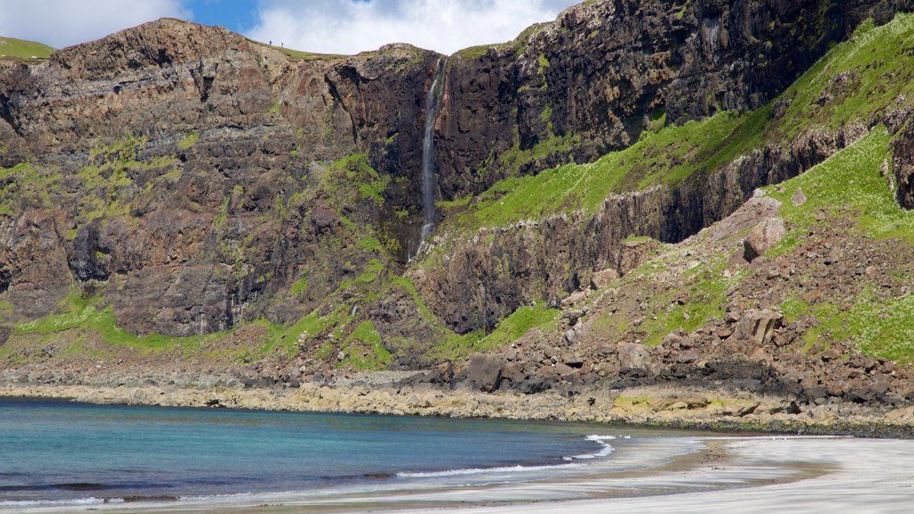 Isle of Skye which includes mountains, a sandy beach and rocky coastline