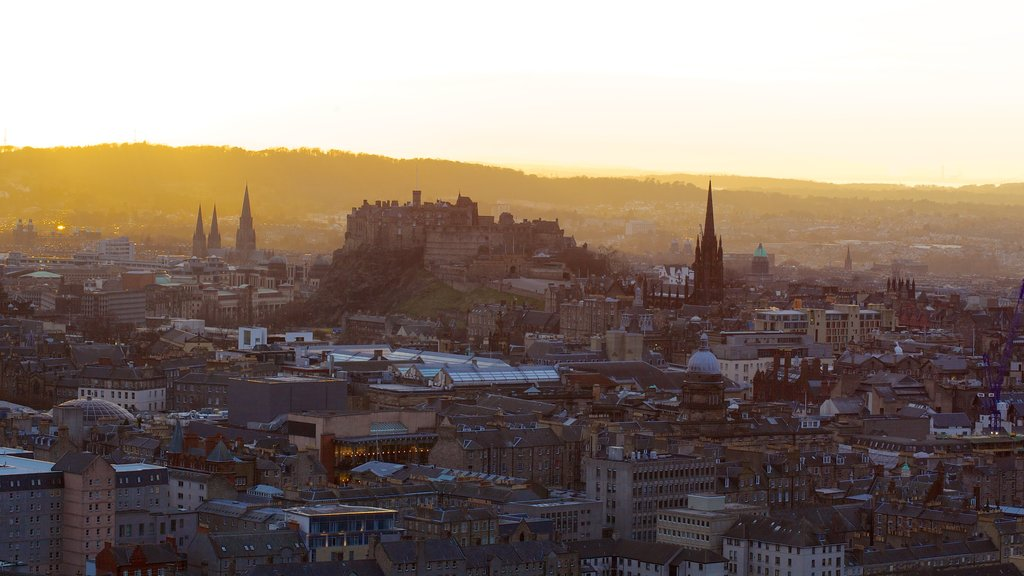 Arthur\\\'s Seat featuring a city and a sunset