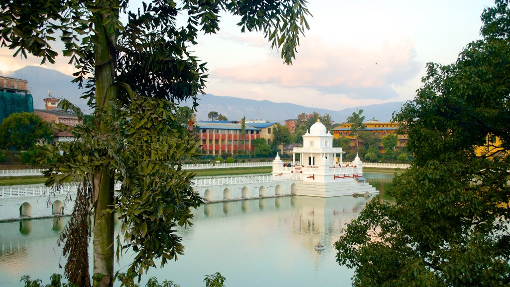 Nepal showing a temple or place of worship, a lake or waterhole and a bridge