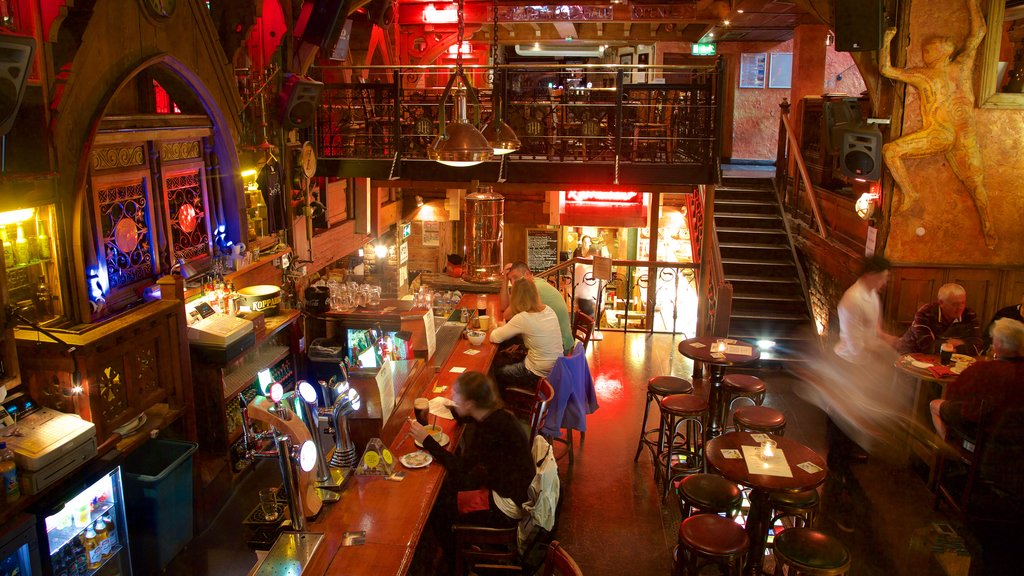 Galway showing a bar and interior views as well as a small group of people