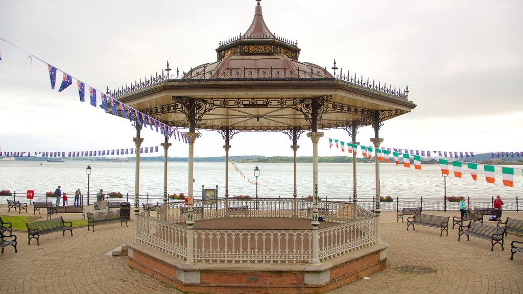 Cobh which includes a lake or waterhole and a square or plaza