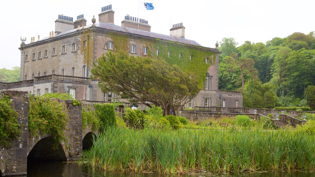 Westport House featuring a bridge, heritage architecture and a river or creek