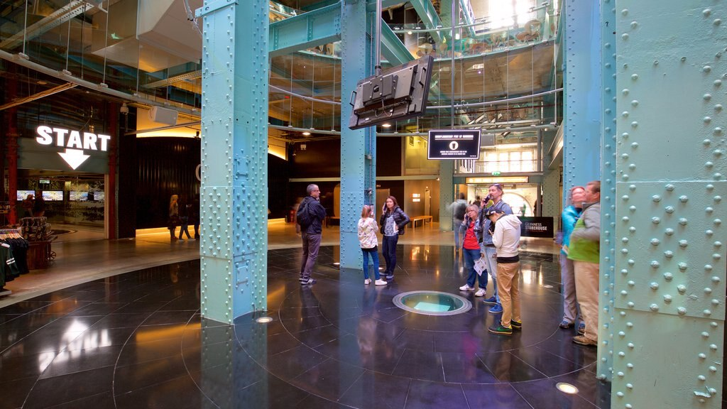 Guinness Storehouse showing interior views and signage as well as a small group of people
