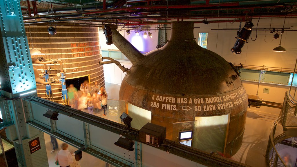 Guinness Storehouse which includes signage and interior views as well as a small group of people
