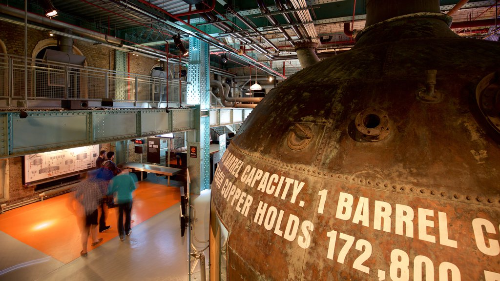 Guinness Storehouse which includes interior views and signage as well as a small group of people