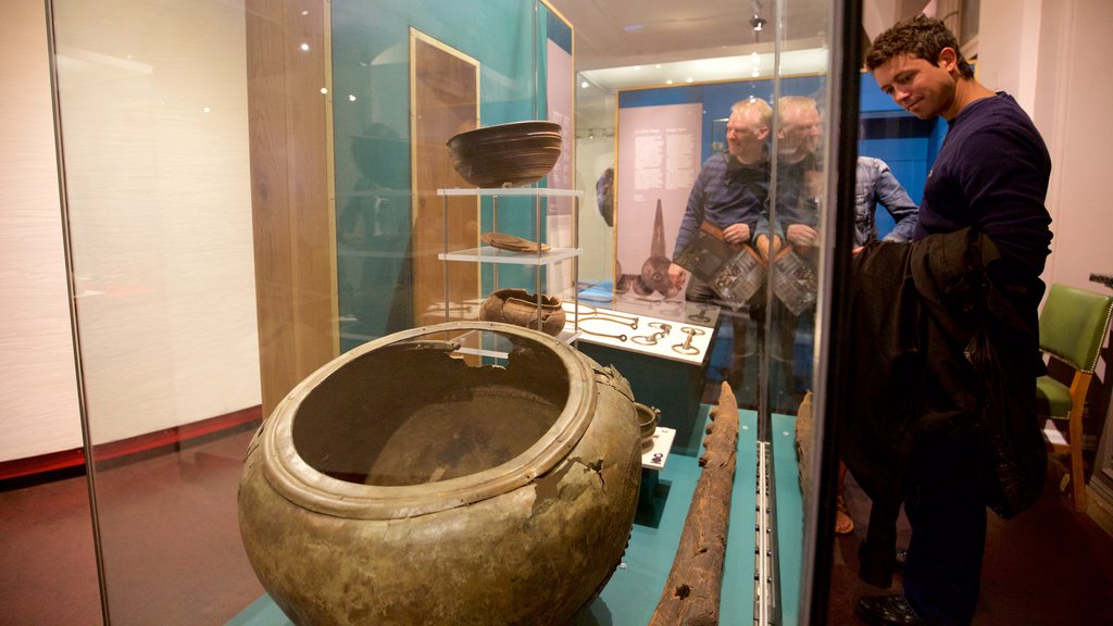 National Museum of Ireland - Archaeology and History featuring interior views as well as a small group of people