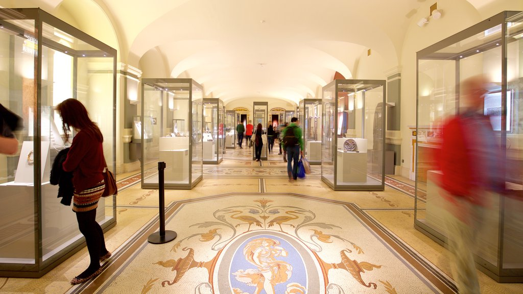 National Museum of Ireland - Archaeology and History showing interior views and heritage elements as well as a small group of people