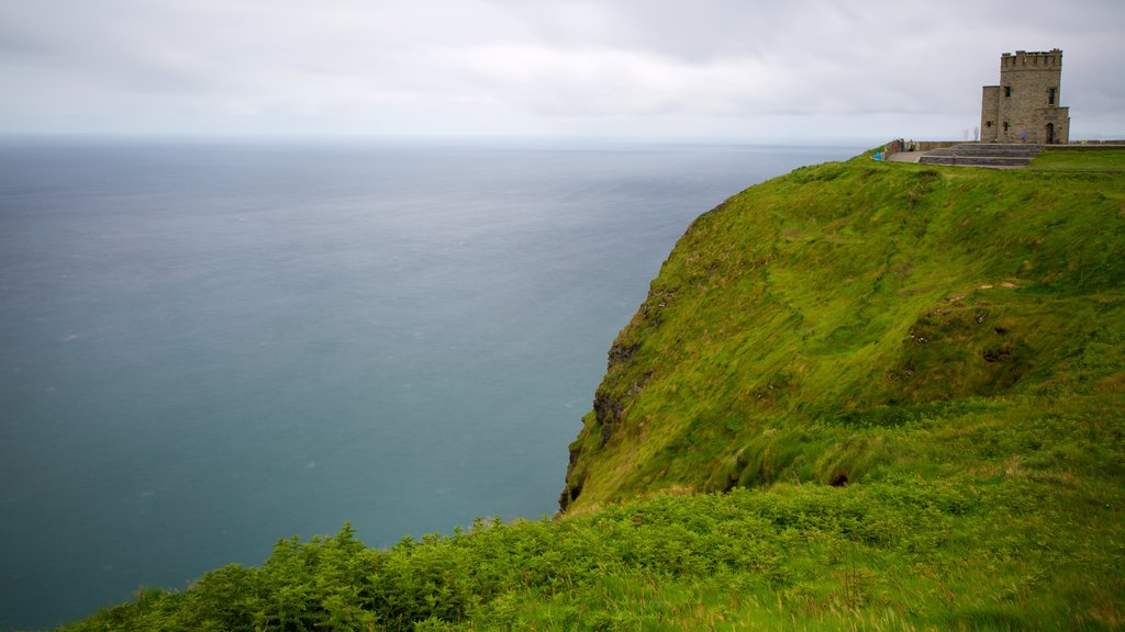 Cliffs of Moher showing rocky coastline, heritage elements and chateau or palace