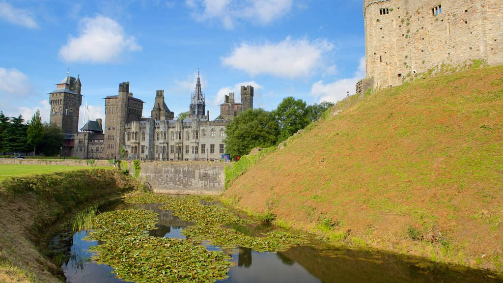 Cardiff Castle showing a river or creek, a castle and heritage elements