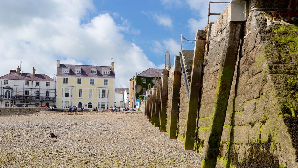 Beaumaris which includes a coastal town and a pebble beach