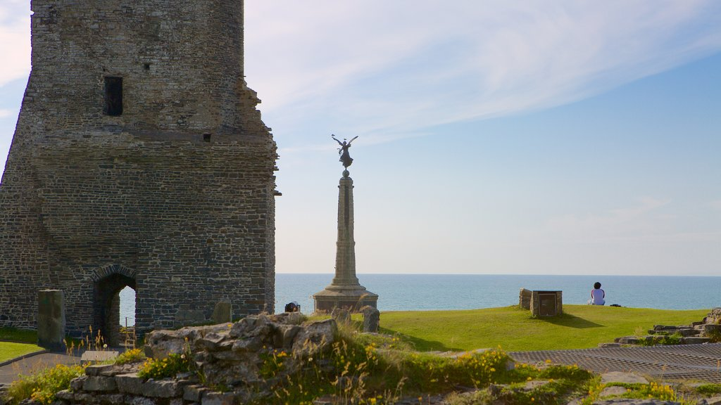 Aberystwyth Castle featuring a monument, general coastal views and a ruin