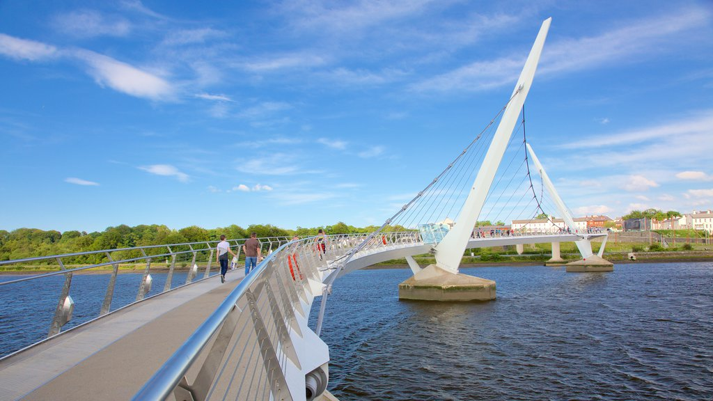 Peace Bridge showing a bridge, modern architecture and a river or creek