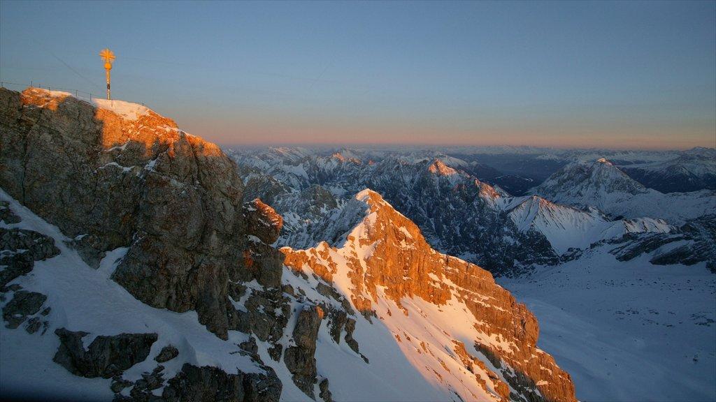 Garmisch-Partenkirchen Ski Resort which includes snow, a sunset and tranquil scenes