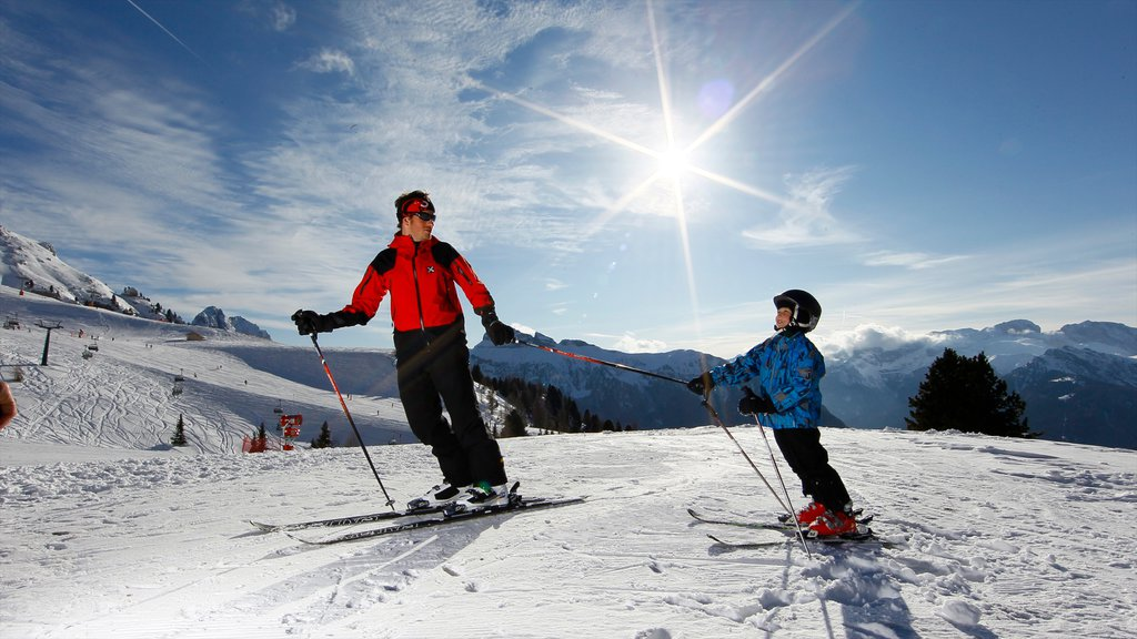 Fassa Valley showing snow and snow skiing as well as a small group of people