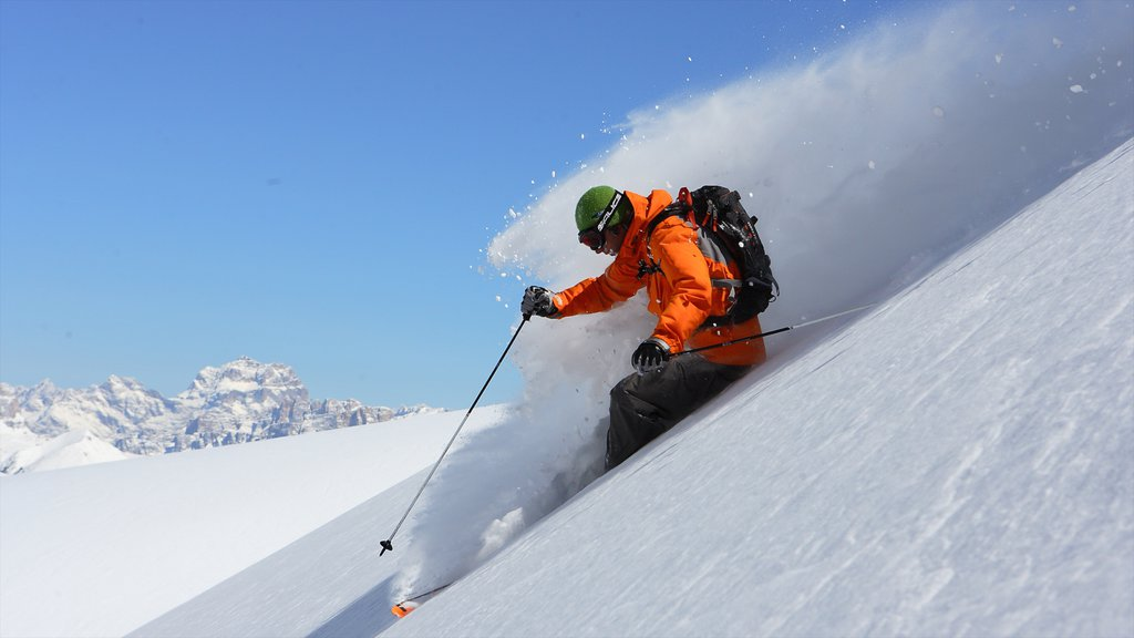 Fassa Valley which includes snow skiing and snow as well as an individual male