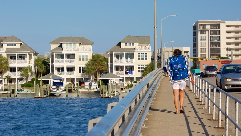 Wrightsville Beach featuring a bridge, a river or creek and a house